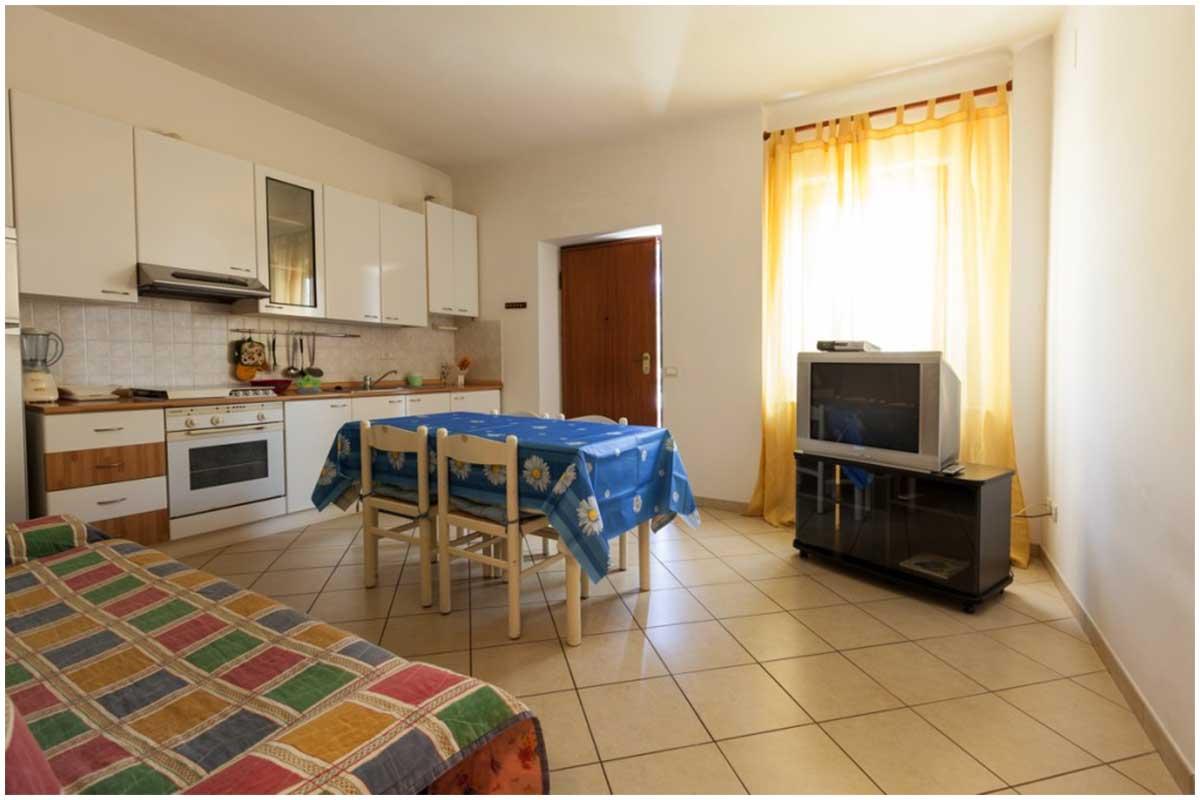 Sala appartamento con Tv e divano letto
